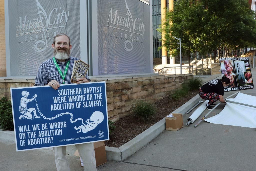 Pastor Clay Hall of Kentucky demonstrates against abortion and in favor of a resolution to abolish abortion.