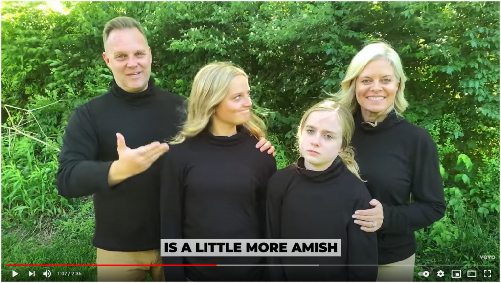 """Matthew West, his daughters and his wife pose in a music video for his tongue-in-cheek new single """"Modest is Hottest."""""""